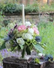 Wedding reception flowers with candle